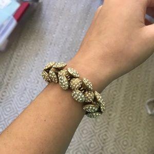 Rhinestone covered gold bracelet